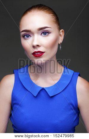 Make Up. Beautiful Blonde Girl. Isolated on dark gray background