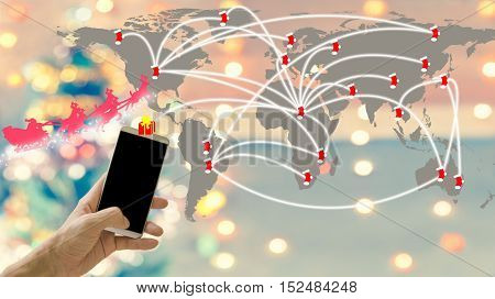 Christmas time. Christmas worldwide by your hand. You can send gift to people on Christmas for a worldwide with fingertips. Suitable for connection on Christmas and everything about Christmas concept.