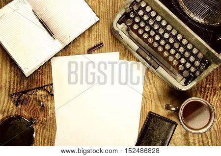 Vintage old English typewriter on the texture wooden sheet of plywood
