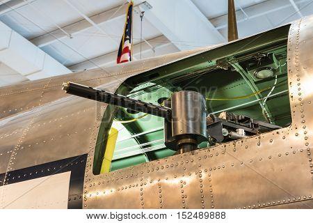 Side mounted machine gun on a viintage warplane. Gun pointed out the side window