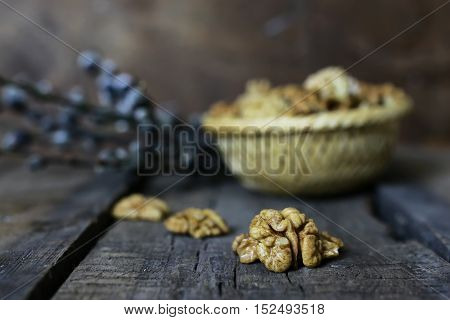 Dried chopped walnuts on a wooden background old shabby