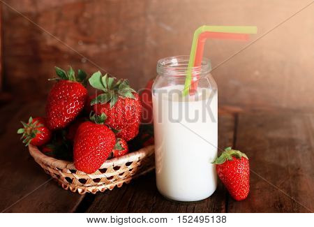 juicy flavorful red ripe strawberry on a wooden natural background