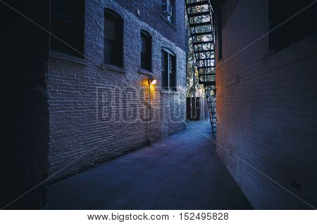 burning lantern in a dark alleyway. city backyards