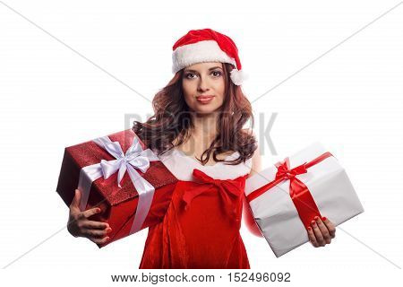 Young attractive girl in a suit of Santa Claus holds two Christmas present. She is happy. Sale. Christmas mood.