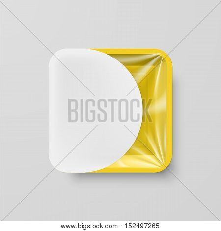 Empty Yellow Plastic Food Square Container with White Label on Gray