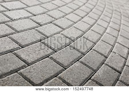 gray cobbles on street walkway dry sunny day