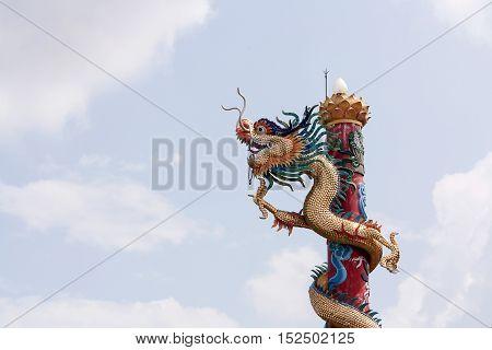Chinese dragon. Dragon status. dragon pillars on the blue sky