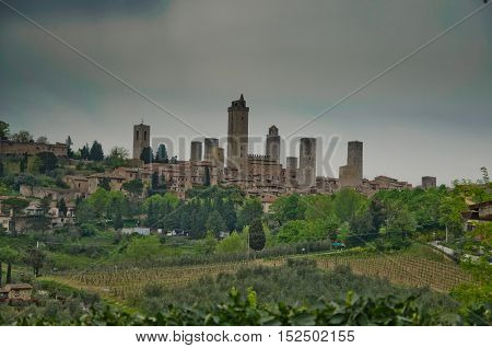 panorama of San Gimignano with its medieval towers which dominate the Tuscan green valleys