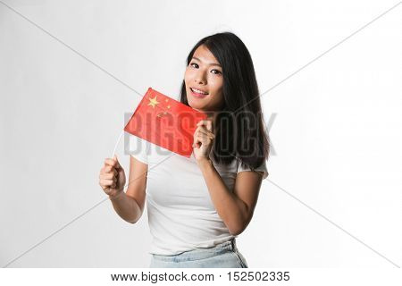 Chinese woman holding up a Chinese flag against white background