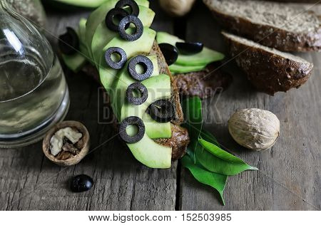 ripe juicy buttery avocado on a wooden table old textural