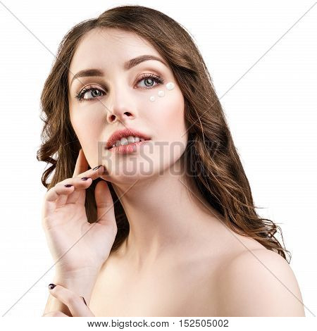 Young woman with cosmetic cream on clean fresh face. Skin care concept