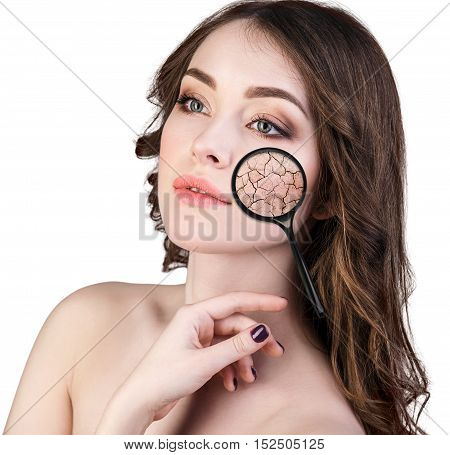 Face of young woman with dry skin. Concept of treatment and skin care.