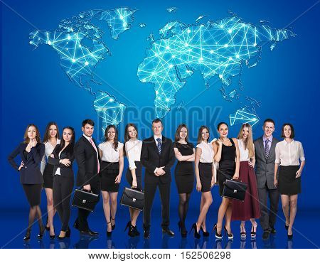 Group of business people over world map behind them. Elements of this image furnished by NASA