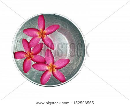 red flowers floating in silver bowl isolated on white background, for Songkran festival in Thailand