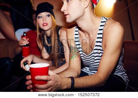 Young People Hanging Out in Club Lounge