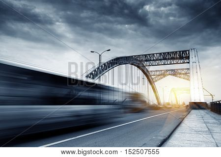 The car quickly crossed the modern building bridge.