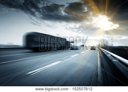 Fast-moving cars on a high-speed road blurred