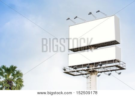 Double blank billboard or poster for outdoor advertising. Blank billboard on highway. Big blank billboard for advertisement.