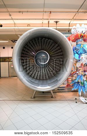 AMSTERDAM, NETHERLANDS - CIRCA NOVEMBER, 2015: plane engine at Schiphol Airport. Amsterdam Airport Schiphol is the main international airport of the Netherlands.