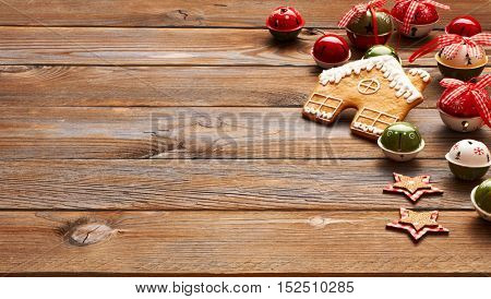 Christmas homemade gingerbread house cookie and decoration on wooden background