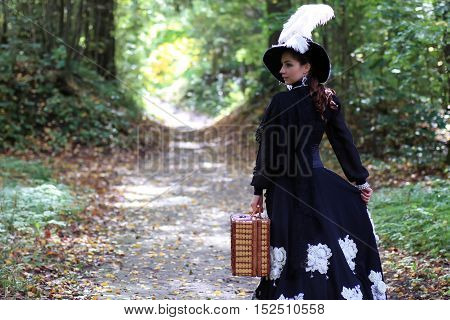 beautiful girl in Victorian dress in the manor summer day
