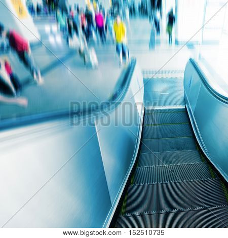 Passengers and Escalators in Pudong Airport Terminal Building, Shanghai, China.