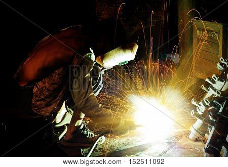 The workers in the steelworks are undergoing welding operations.