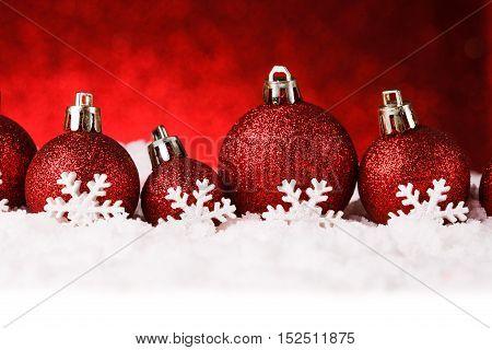 red christmas balls on snow. studio shot
