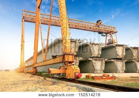 Precast concrete construction site bridge construction sites and large overhead cranes.