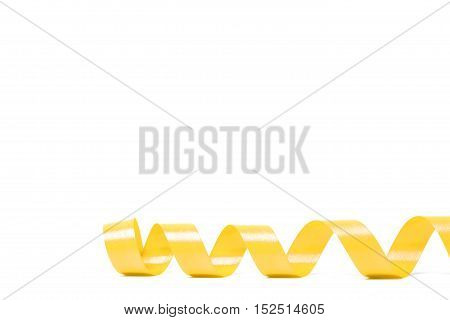 yellow satin ribbon on white background. studio shot
