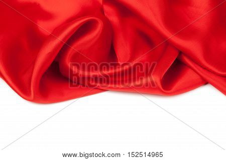Red satin fabric against white background. studio shot