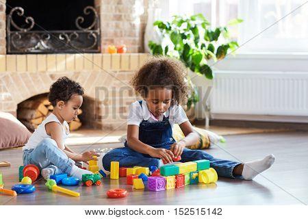 Siblings playing