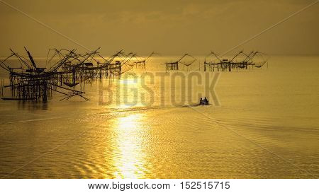 Fishing boats in the morning with soft sunlight .