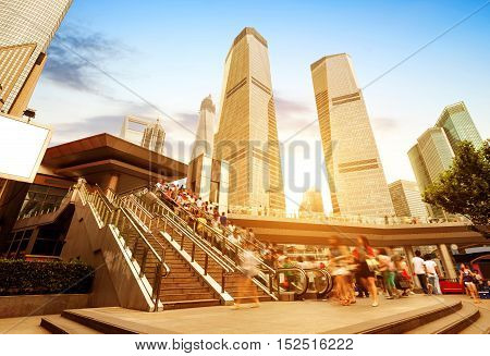 Escalator next to skyscrapers on the streets of Shanghai.