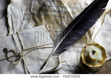 retro old communication concept letter paper and feather for writing