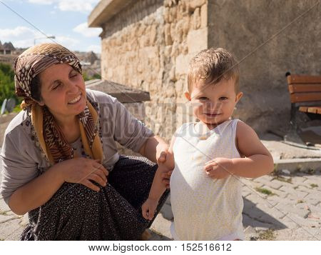 Goreme Nevsehir Turkey - September 16 2016: Local happy mom and child in Goreme Cappadocia region.