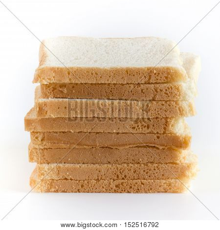Stack of sliced white bread on white background