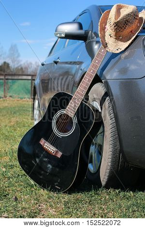 black acoustic guitar in the hands of a talented country music artist