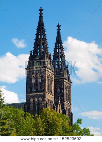 Two towers of Saint Peter and Paul Cathedral, Vysehrad, Prague. Detailed view on sunny summer day with blue sky on background.
