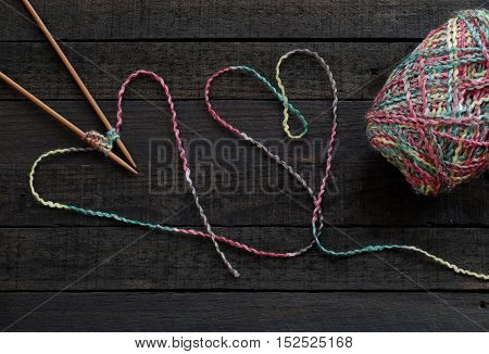 Knitted Background, Knitting Needle And Yarn