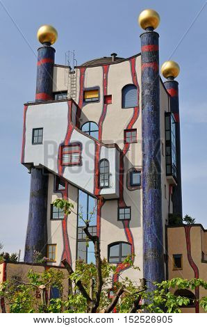 Stuttgart, Germany - April 21, 2014. Colorful residential apartment building designed by architect Hundertwasser. Plochingen, Stuttgart, Germany.