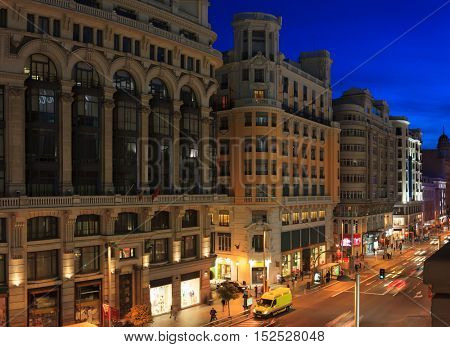 Gran Via street at late evening, Madrid, Spain.