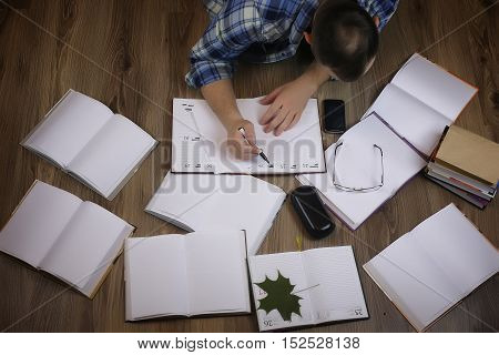 man working with book on the floor education and bussines concept