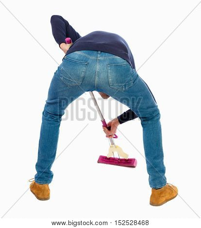 Back view of a man washing floor mop. He is busy cleaning. Rear view people collection.  backside view of person.  Isolated over white background. Man in warm jacket intensively washes the floor.