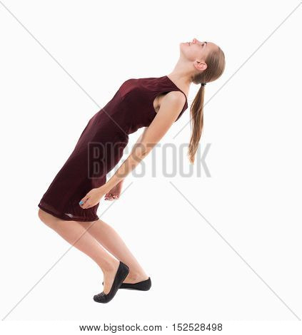 Balancing young woman.  or dodge falling woman. Rear view people collection.  backside view of person.  Isolated over white background. A girl in a burgundy dress falls on his back.