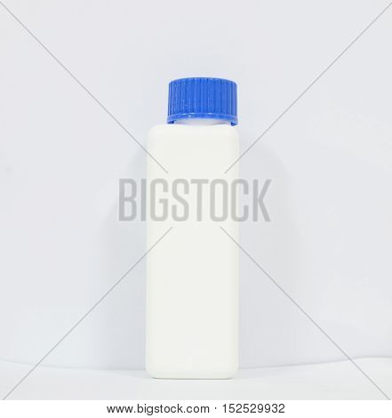 White bottle reagent.scientist with equipment and science experiments Laboratory glassware containing chemical liquid