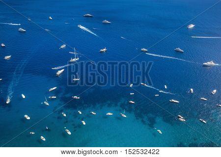 Many yachts and boats on the sea near Capri Island Italy