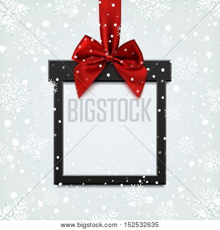 Blank, black square banner in form of Christmas gift with red ribbon and bow, on winter background with snow and snowflakes. Brochure or banner template.