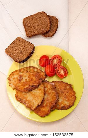 Potato Pancakes With Meat And Tomatoes On Green Plate With Rye Black Bread In Belarusian Style On Li