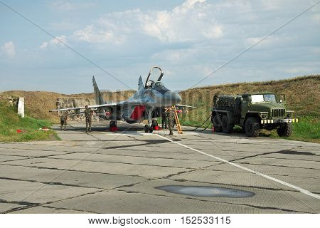 Vasilkov Ukraine - August 3 2012: Ukrainian Air Force Mig-29 fighter plane is being prepared for a training flight